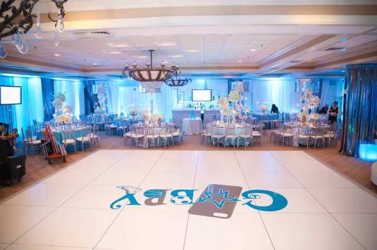 mitzvah-for-gabby-white-portable-dance-floor-with-logo-sticker-decorated-tables-and-metallic-drapes